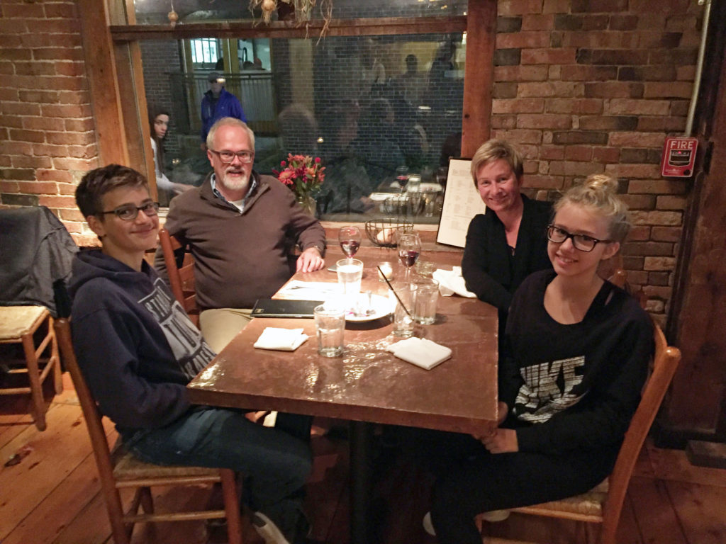 Family eating at restaurant in Maine